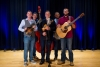 Jake Mosley--mandolin, Alex Donahue--bass, Mike Mitchell--violin and songwriter, Tay Wellington--banjo, Joey Mosley--guitar