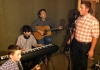 Nicholas Hickman rehearses with the band of Colton Brown on piano, Caleb Lewis on guitar and producer Randall Franks on guitar.