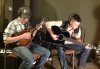 Phillip Cross on mandolin and Isaac Moore on guitar play on Farther Along.