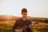 Jack Smith is our 15-year-old mandolin player. Jack has been playing mandolin for a little under 2 years now and has won multiple awards. He is currently a junior in high school and also enjoys playing for his local high school soccer team.